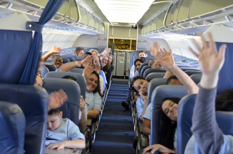 wWaving on plane